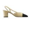 Two-tone suede and grosgrain slingback