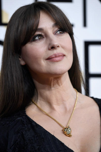 Monica Bellucci wears the Panthère de Cartier necklace in 18k yellow gold with lacquer, tsavorite, garnet, onyx and diamonds