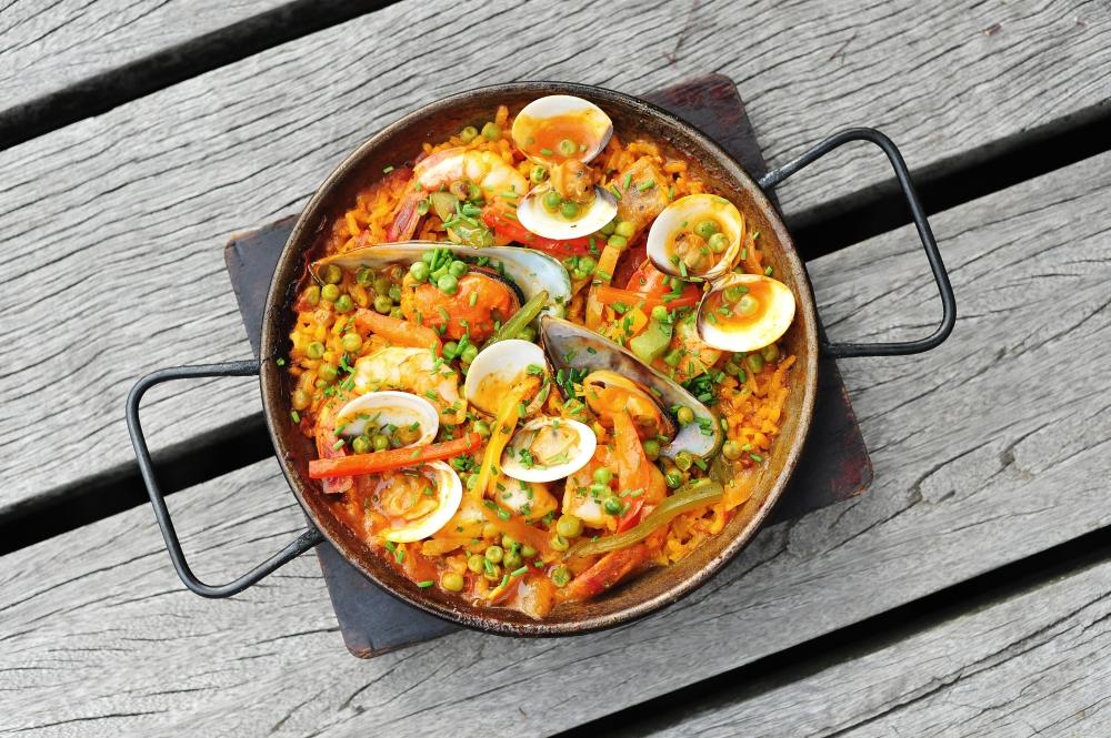 Dining highlights this month prestige online society s - Paella de pescado ...