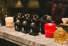 Several of Amouage's most popular perfumes and home fragrances on display in Bangkok's House on Sathorn in 2015.