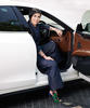 Pornsarin Maethivacharanondh; Blazer and trousers by Sanshai, Shoes by Sergio Rossi, Jewellery by Tiffany & Co, Car by Maserati (Quattroporte); Pho...