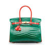 This custom Birkin in crocodile ups the ante with the power pairing of two covetable colours: Vert  Émeraude and Géranium.