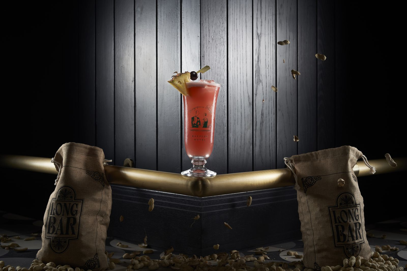 Enjoy the classic Singapore Sling at the Long Bar. (Photo: Raffles Hotel Singapore)
