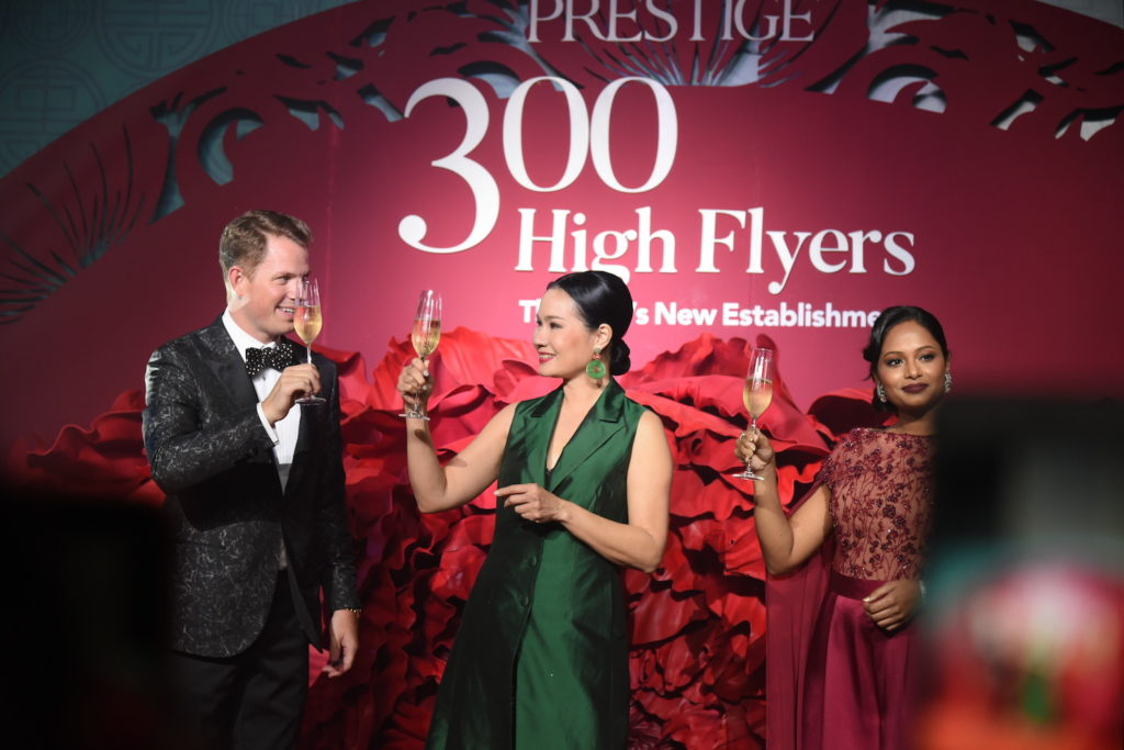 Waraporn Siriboonma, Richard Nielsson and Reena Hallberg toasting the 300 High Flyers