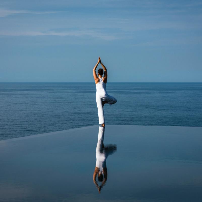 Yoga at Cliff pool, Amanoi