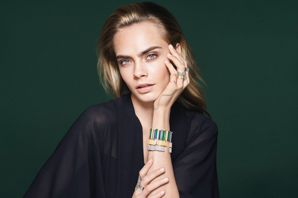 Stack Gem Dior bangles for a striking look