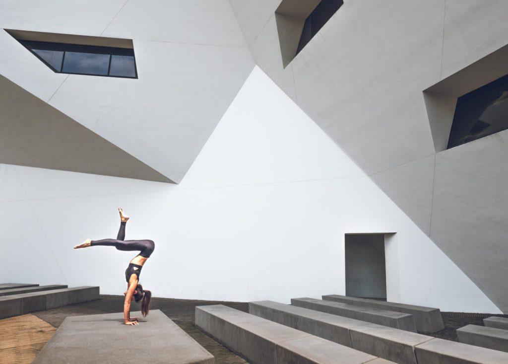 Jennie Cheung doing handstands around the city