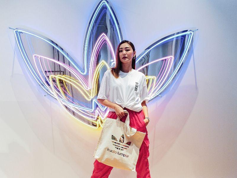 May Ho carries a batik imprint Trefoil logo tote bag