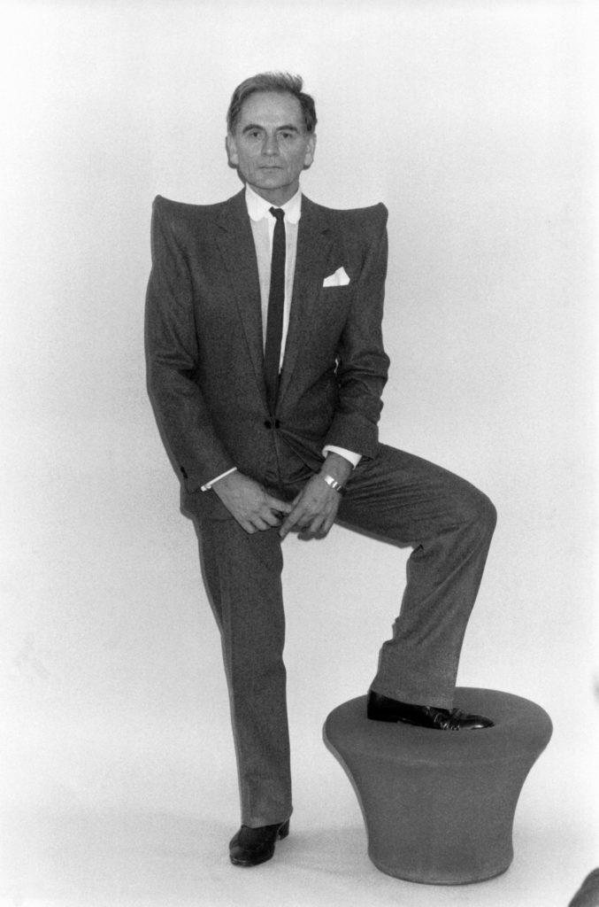 Pierre Cardin wearing pagoda shoulders