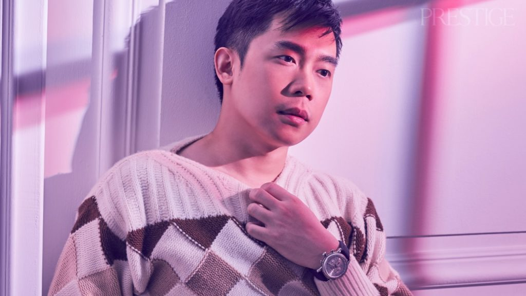 Vincent Lua wears Salvatore Ferragamo sweater and pants; Chopard Mille Miglia Chronograph in stainless steel