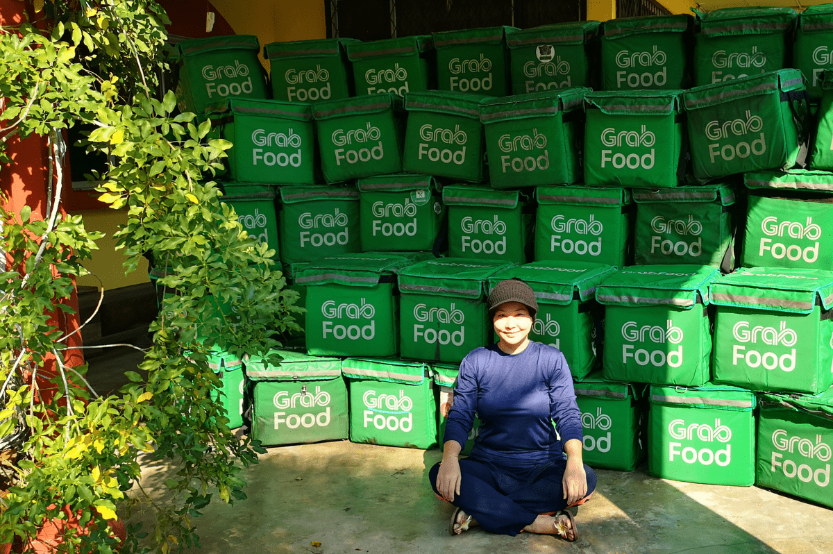 Upcycling used Grabfood delivery bags into school bags, pencil cases and purses for poor kids