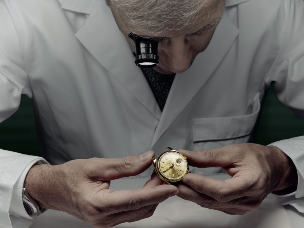 At Rolex World Service, The watch is closely examined by a watchmaker, who assesses the work to be done.