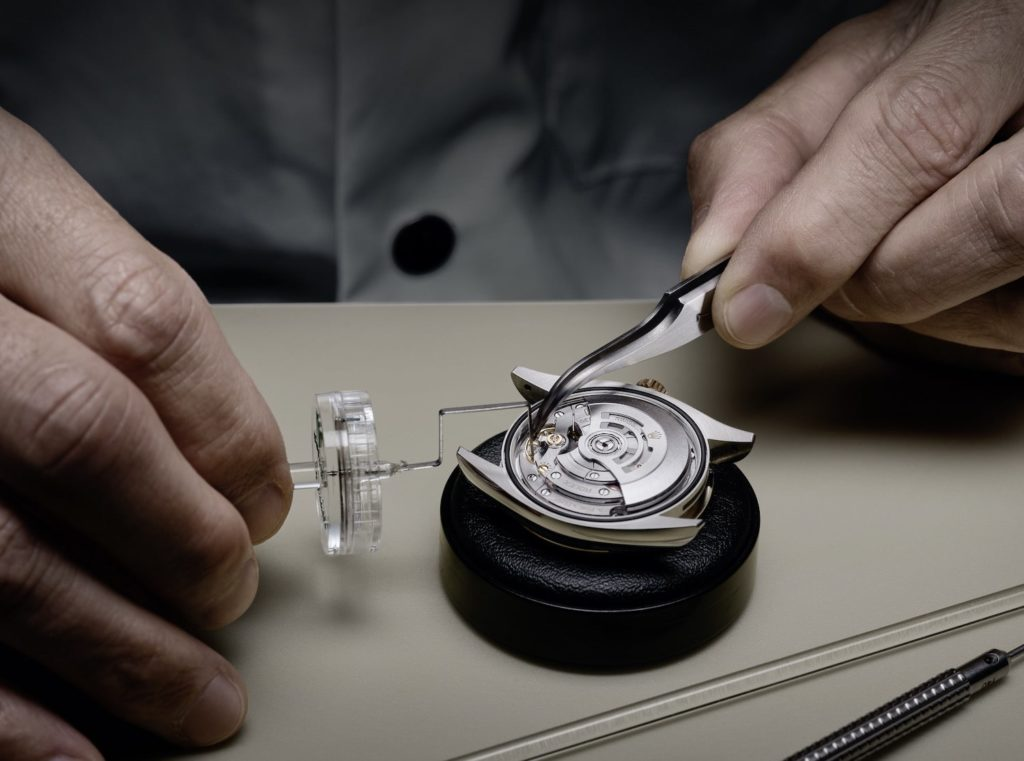 The movement's timekeeping accuracy is adjusted using a microstella regulating key.
